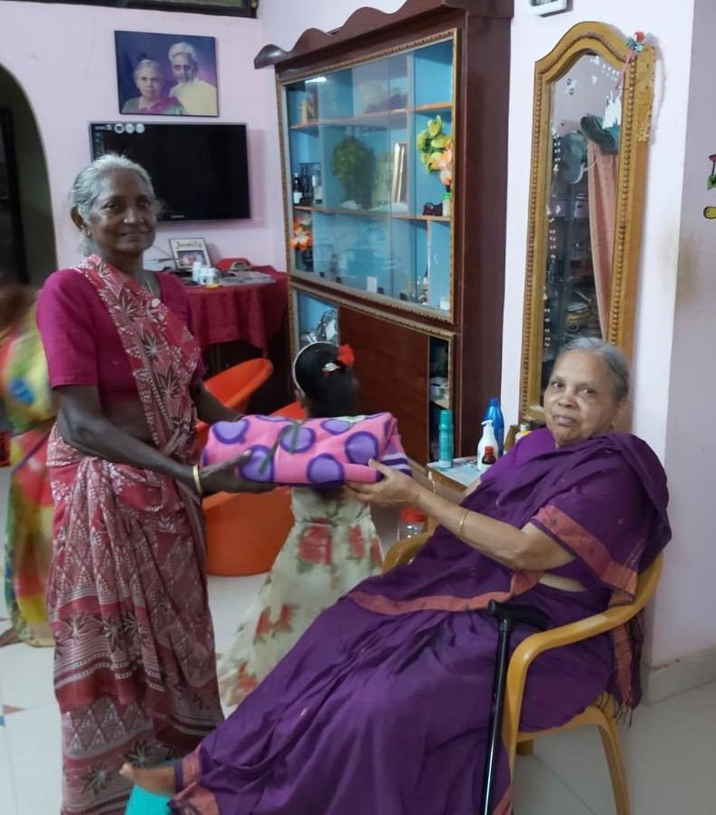 Former School Teacher,Mummy Peddoju,Gives a Sari to Gangamma, our Teachers Aide at the School Since It's 2009 Opening